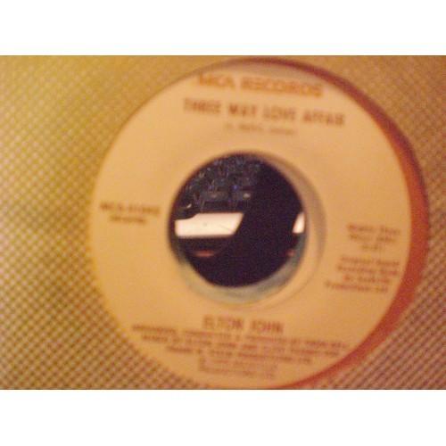 45 RPM: #6034.. ELTON JOHN - THREE WAY LOVE AFFAIR & MAMA CAN'T BUY YOU LOVE /
